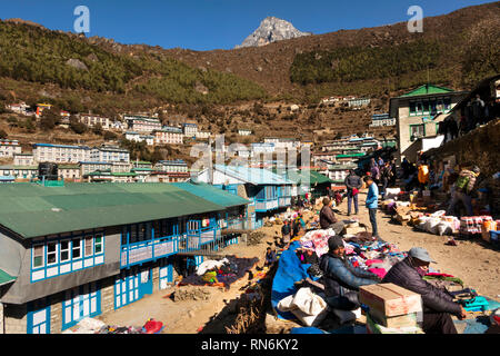 Nepal, Namche Bazaar, Market, local shoppers and traders in sunshine - Stock Photo