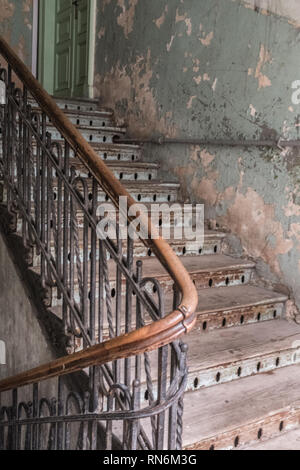 old wooden staircase leading to a room in a tenement block - Stock Photo