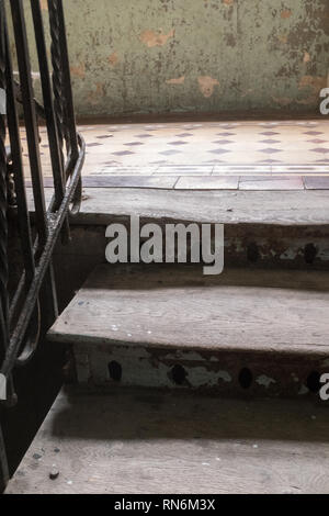 two wooden steps onto a landing in an old eastern european house - Stock Photo
