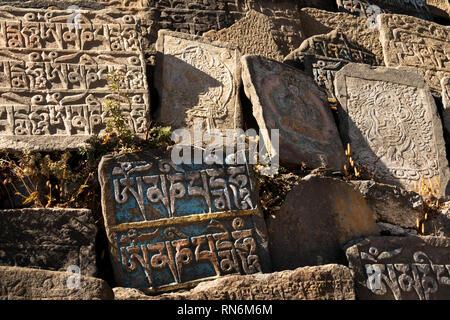 Nepal, Namche Bazaar, Buddhist Mani Wall stones engraves with Tibetan Script mantras - Stock Photo
