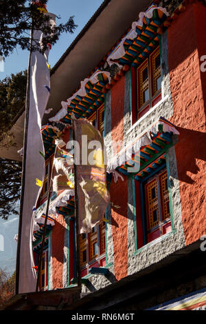 Nepal, Namche Bazaar, traditionally built, painted Buddhist Gompa above the town - Stock Photo