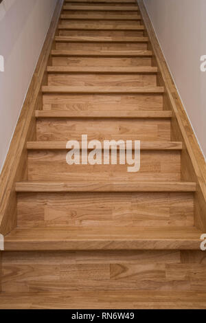 long wooden stairs, modern house interior close-up - Stock Photo