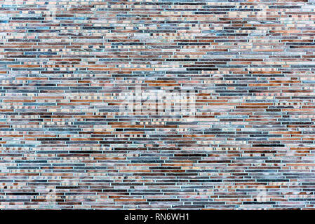 Background from a wall made of small clinker bricks - Stock Photo