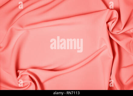 Background drapery fabric closeup. Color of year 2019 Living Coral - Stock Photo