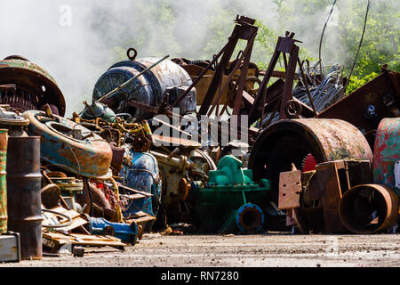 Illegal garbage dump. Large pile of metal waste. The concept of ecology pollution. - Stock Photo