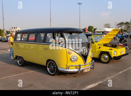 Bangkok, Thailand - February 9, 2019: Vintage Yellow VW van and VW Type 181 owners gathering at volkswagen club meeting in Siam VW festival - Stock Photo