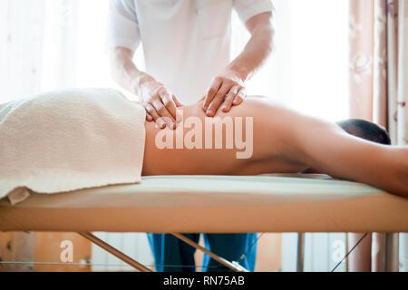 Photo of man therapist giving massage to man . - Stock Photo