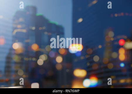 Night city lights bokeh background,lights blurred building bokeh background for design colorful of city night - Stock Photo