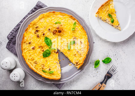 Homemade tuna pie with tomatoes and basil, top view. - Stock Photo