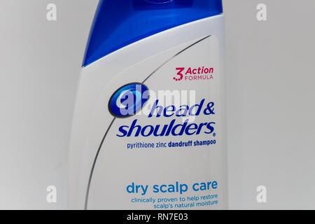 ST. PAUL, MN/USA - FEBRUARY 16, 2019:  Head & Shoulders shampoo bottle and trademark logo. Head & Shoulders is an American brand of anti dandruff sham - Stock Photo