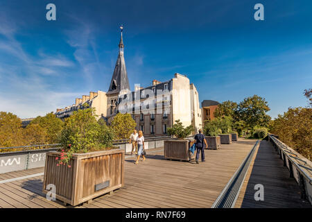 People walking along the elevated urban garden of Promenade Plantée , an elevated park walkway in the 12th arrondissement of Paris . - Stock Photo