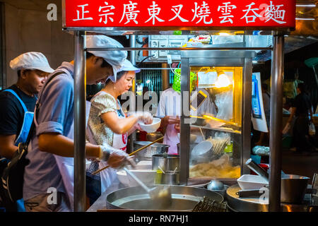 Bangkok, Thailand, January 12 2019: Many people eating street food on the lively Yarowat Road, also known as Chinatown - Stock Photo