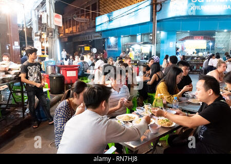 Bangkok, Thailand, January 12, 2018: Many people eating street food on the lively Yarowat Road, also known as Chinatown - Stock Photo