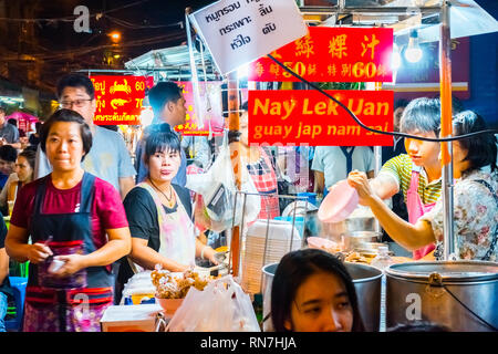 Bangkok, Thailand, January 12 2018: Many people eating street food on the lively Yarowat Road, also known as Chinatown - Stock Photo