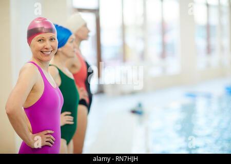 Senior Swimmers in Pool - Stock Photo