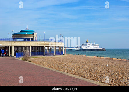 View of Eastbourne Pier, Bandstand, Beach and Seafront from the Promenade, England, UK - Stock Photo