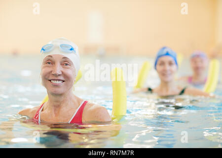 Happy Women Working Out in Water - Stock Photo