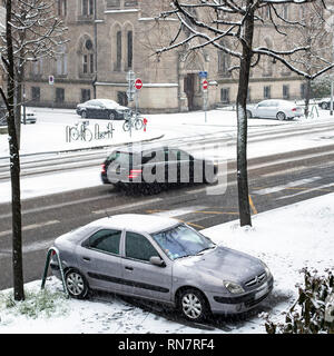 Strasbourg, Alsace, France, snowy street, parked car on pavement, traffic, - Stock Photo
