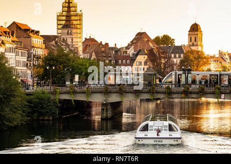 Strasbourg, Alsace, France, Batorama sightseeing river cruise boat, Ill river, Pont Royal bridge, tram stop, late afternoon light, - Stock Photo