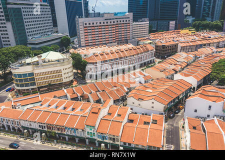 Singapore / Singapore - February 17 2019: Aerial bird's eye view of art deco shophouses along Tanjong Pagar Chinatown Conservation area in elegant mut - Stock Photo
