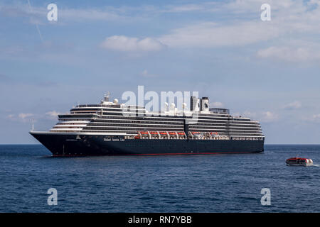A small motor boat takes crew to MS Oosterdam, a cruise ship of Holland America Line anchored near Port Hercules on a sunny day. Monaco - Stock Photo