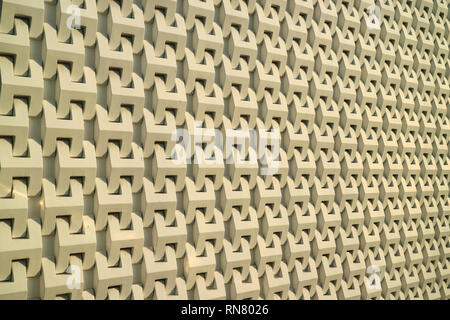 3D pattern of a modern building's outer wall in the warm sunlight - Stock Photo