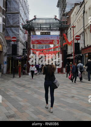 Girl taking a picture in Chinatown London central. - Stock Photo