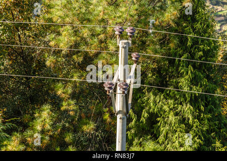 high voltage power line, wires attached to insulators, top view - Stock Photo