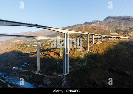 highway overpass bridge in the mountains at sunrise, China - Stock Photo
