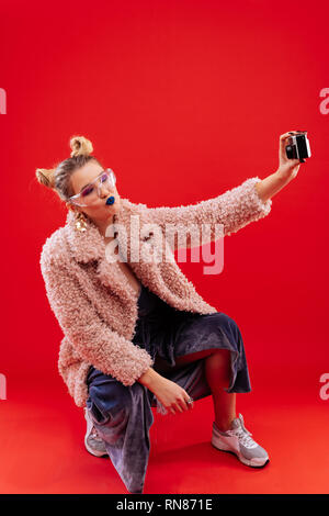 Woman with blue lips making selfie for her boyfriend - Stock Photo