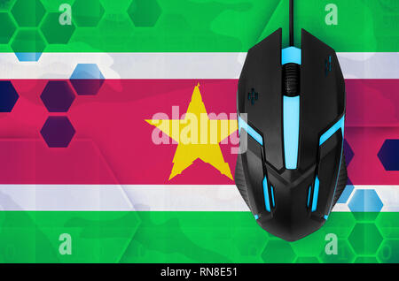 Suriname flag  and modern backlit computer mouse. Concept of country representing e-sports team - Stock Photo