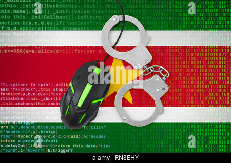 Suriname flag  and handcuffed modern backlit computer mouse. Creative concept of combating computer crime, hackers and piracy - Stock Photo