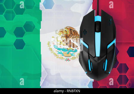 Mexico flag  and modern backlit computer mouse. Concept of country representing e-sports team - Stock Photo