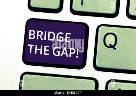 Handwriting text writing Bridge The Gap. Concept meaning Overcome the obstacles Challenge Courage Empowerment Keyboard key Intention to create compute - Stock Photo