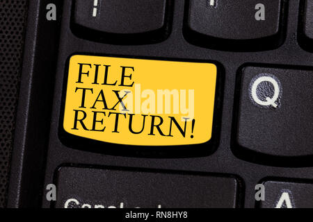 Word writing text File Tax Return. Business concept for Paperwork to get financial money returning accountant job Keyboard key Intention to create com - Stock Photo