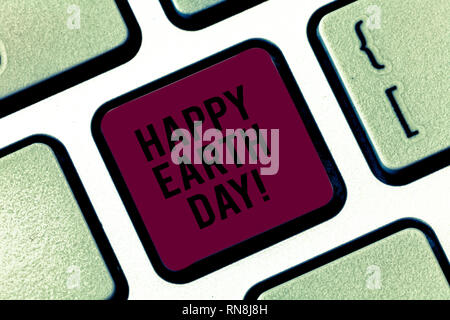 Handwriting text Happy Earth Day. Concept meaning Worldwide celebration of ecology environment preservation Keyboard key Intention to create computer  - Stock Photo