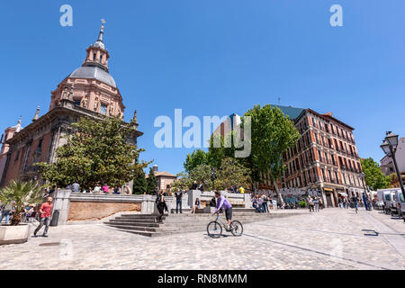 People outside the St. Andrew's Church, Iglesia de San Andrés Apostol in Plaza de San Andrés, Madrid, Spain - Stock Photo