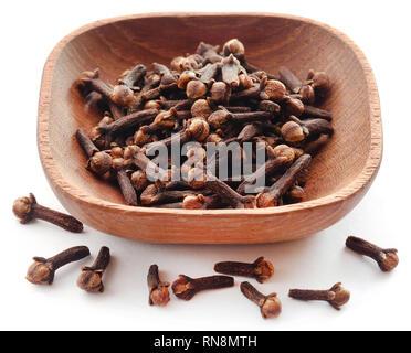 Organic fresh cloves in bowl over white background - Stock Photo
