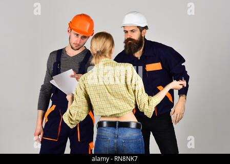 Creating perfection. Construction workers team. Professional people working on construction design. Group of constructing engineers and architects at - Stock Photo