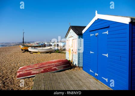 Beach huts and fishing boats on the Bulverhythe beach, West St Leonards-on-Sea, East Sussex, UK