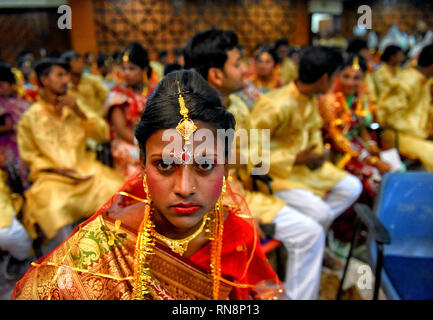 Girls are seen getting ready and  as they wait for the marriage ceremony during the Mass Marriage programme at Kolkata. Mass marriage programme was organised on the eve of the Valentine week of 164 Couples in the city of Kolkata by a NGO named Aloy Fera. - Stock Photo