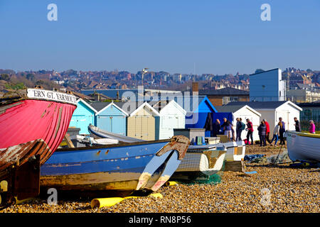 Old fishing boats and beach huts on the Bulverhythe beach, West St Leonards-on-Sea, East Sussex, UK