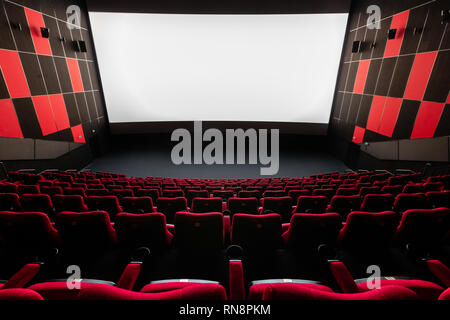 Russia, Nizhny Novgorod - November 14, 2016: Cinema Imperia Grez Nebo, Dolby Atmos. Empty red cinema hall seats, comfortable and soft chairs - Stock Photo