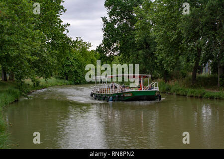 Carcassonne, France; June 2017: view of a Boat in the Canal du Midi near Carcassonne. A World Heritage Site - Stock Photo