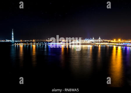 Europe's tallest skyscraper, the Lakhta center towers over the cruise port and ships late night on the coast of the Baltic in St.Petersburg, Russia - Stock Photo