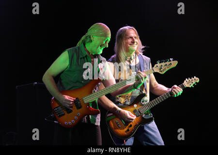 Deep Purple bassist Roger Glover and guitarist Steve Morse are shown performing together during a 'live' concert appearance. - Stock Photo