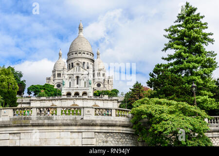 Basilica Sacre Coeur in Montmartre in Paris, France in sunny day - Stock Photo