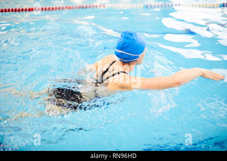 Woman Swimming in Pool - Stock Photo