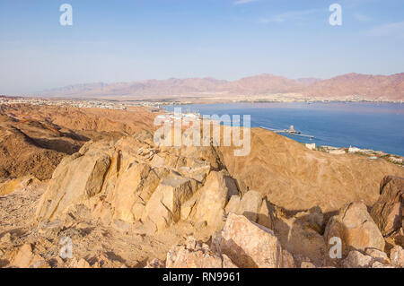 Amazing panoramic view on Eilat cityscape, Red Sea and Jordan from the Mountain or Har Cfachot in Eilat ,Israel - Stock Photo