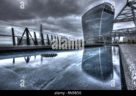 View of Gherkin from London rooftop - Stock Photo